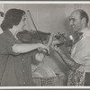 George Avakian and Anahid Ajemian in their kitchen