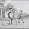 Performers rehearsing fight choreography (unidentified man in foreground backbent) for the stage production Henry IV, [Part I] at the Delacorte Theater