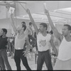Performers (arms raised) in rehearsal for the stage production Dreamgirls