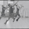 Musicians leaping in rehearsal for the stage production Dreamgirls
