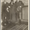 Robert H. Davis and two others on a boat