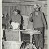 Woman ironing, man talking