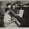 Teacher and student at piano, Jewish Settlement