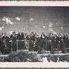 Postcard depicting Arturo Toscanini conducting an orchestra
