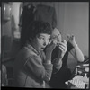 [B3-21] Lee Theodore and Irene Sharaff during make-up session in dressing room during rehearsals for the stage production West Side Story
