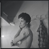 [B3-21] Chita Rivera applying make-up in dressing room during rehearsals for the stage production West Side Story