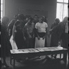 [B3-22B] Jean Rosenthal, Irene Sharaff, Arthur Laurents, Leonard Bernstein, Jerome Robbins, Sylvia Drulie, and Robert E. Griffith consulting Sharaff's costume designs during rehearsal for the stage production West Side Story