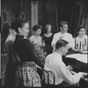 Chita Rivera, Stephen Sondheim, Leonard Bernstein, Carol Lawrence and other cast members around piano during rehearsal for the stage production West Side Story