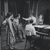 Carol Lawrence, Stephen Sondheim (at piano), Leonard Bernstein, and other cast members during rehearsal for the stage production West Side Story