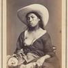 Studio portrait of an unidentified Peruvian woman breastfeeding