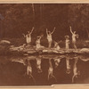 Dancers in Greek poses by the water