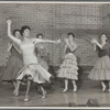 "Chita Rivera (foreground) and Shark girls perform ""America"" in the stage production West Side Story"