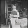 Diana Sands (holding book) in the stage production Raisin in the Sun