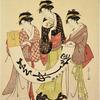 Three women looking at a kakemono