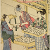 Women arranging cocoons in trays