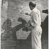 Jerome Robbins drawing with chalk on brick wall during West Side Story 1961 movie production