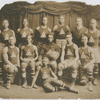 Group portrait showing Wesley Williams (kneeing at left) with fellow members of the 1919-1920 AMA Basketball Team