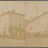 Street view of hotel building with group of men standing next to horse and carriage, Ohio