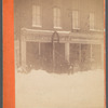 Group of people standing outside Gilbert G. Gaston store in snow scene], Steubenville, Ohio