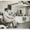 Dr. Martin Luther King, Jr., center, addressing a group of Harlem ministers in preparation for the Prayer Pilgrimage for Freedom to Washington, D.C