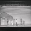 Billy (John Raitt), center, briefly appears to Julie (Jan Clayton) and Louise (Bambi Linn), as the principal (Lester Freedman) looks on