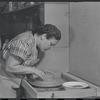 Woman making pottery