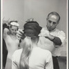 Jerome Robbins adjusting a dancer's hat, no. 310