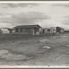 """Street and homes in """"Little Oklahoma."""" Forty families in this group. Tents, tent houses, shacks, freight cars converted into homes"""