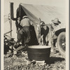 Migrant camp [California?]. Tent with wash tub in foreground.