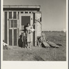 Resettled at Bosque Farms project. Family of four from Taos Junction shows temporary dwelling