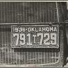 Radiator and license of Oklahoma cotton picker's car. San Joaquin Valley, near Fresno, California.
