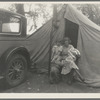 Mother and three children in a California squatter camp.