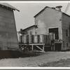 Cotton bales on gin platform. Robstown, Texas