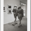 Two men in drag walking in MoMA galleries