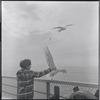 Passenger feeding seagulls on the Princess of Vancouver