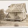 Cotton field hand sitting on her porch on Sunday afternoon. Near Blytheville, Arkansas.