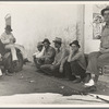 Migrant agricultural workers, idle in town during the potato harvest. Shafter, California.