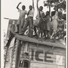 Colored boys playing on top of Coca Cola stand. Little Rock, Arkansas