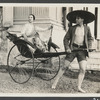 Ruth St. Denis sitting in rickshaw being pulled by Ted Shawn in Singapore, no. 2416