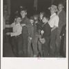 The children crowd and push to reach refreshments at Halloween party. Shafter migrant Camp, California