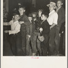 The children crowd and push to reach refreshments at Halloween party. Shafter migrant Camp, California.