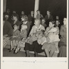 Mothers on the sidelines, watching the Halloween party. Shafter migrant camp, California.