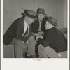 Camp manager, migratory worker, and visitor to the camp in discussion. Shafter camp for migrants, California.