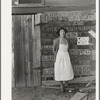 Farm woman beside her barn door. Tulare County, California. No more horseshoes!