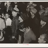 Street meeting at night in Mexican town outside of Shafter, California. Organizer for United Cannery Agricultural Packing and Allied Workers of America (Congress of Industrial Organizations-CIO) talks to mixed crowd. The strike failed.