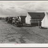 Shafter camp for migrant workers (Farm Security Administration-FSA), California. Tent platforms are supplied. Workers supply their own tents. The newer camps are experimenting with prefabricated steel one-room houses.