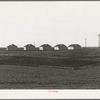 United States government camp for migratory workers (Farm Security Administration-FSA), Westley, California. Pre-fabricated steel shelters replace the use of tents and tent platforms in this newly constructed camp.
