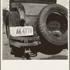 Temporary auto license. A common sight in migratory labor camps. Many enter California after cotton picking in Arizona without sufficient money to buy license plates. California.