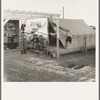 Pergola, cupboard, and tent platform are standard equipment of Farm Security Administration (FSA) migratory labor camp. Brawley, Imperial County, California.