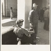 Pea pickers waiting at Farm Security Administration (FSA) office for issue of surplus commodities. Calipatria, California.